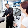 Couple buying a car - Stock Photo