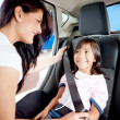 Fastening seat belt in car — Stock Photo #9469347