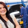 Woman at a car garage — Stock Photo #9469352