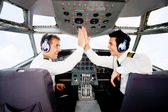 Pilots in an airplane cabin — Stock Photo