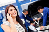 Woman calling mechanic — Stock Photo