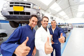 Mechanics with thumbs up — Stock Photo