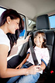 Fastening seat belt in a car — Stok fotoğraf