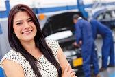 Woman at a car garage — Stock Photo