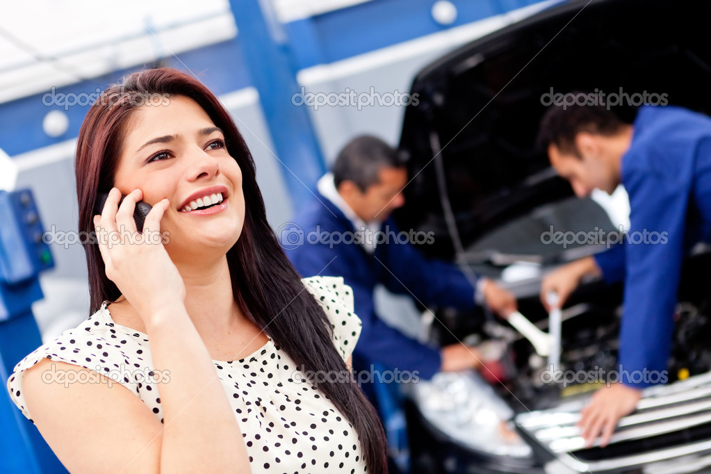 Woman calling mechanic after her car broke down  Stock Photo #9469314