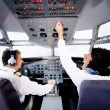 Pilots flying an airplane — Stock Photo