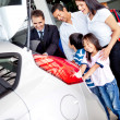Family buying a car - Stock Photo