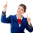 Air hostess pointing destinations - Stock Photo