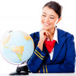 Air hostess with a globe — Stock Photo