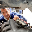 Mechanic fixing an engine — Stock Photo #9495837