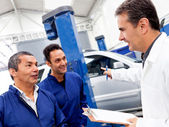 Group of car mechanics — Stock Photo