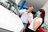 Man buying car to his wife — Stock Photo