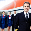 Airplane captain with crew - Stock Photo