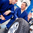 Mechanics working on car puncture — Stock Photo #9525505