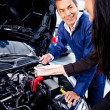 Woman at the mechanic — Stock Photo #9525511