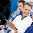 Stock Photo: Mechanics at car garage