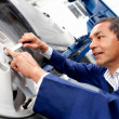 Mechanic working on car puncture — Stock Photo #9525523