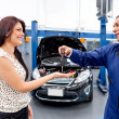 Woman at the mechanic — Stock Photo #9525527