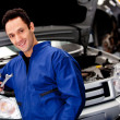 Male mechanic smiling - Stock Photo