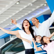 Excited family buying a car — Stock Photo