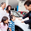 Stock Photo: Family buying a new car