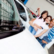 Stock Photo: Happy family with new car