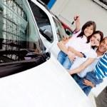 Happy family with new car — Stock Photo