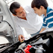 Father and son looking at car engine — Stock Photo