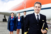 Airplane captain with crew — Stock Photo
