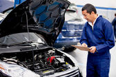 Mechachic checking on a car — Stock Photo