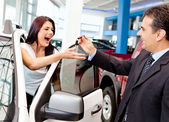 Woman buying a new car — Stock Photo