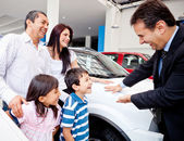 Family buying a new car — Stock Photo