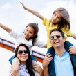 Family traveling by airplane - Stok fotoğraf