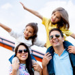 Family traveling by airplane - Stock Photo