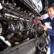 Stock Photo: Mechanic fixing car