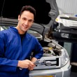 Mechanic at a car garage — Stock Photo #9557658