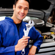 Mechanic holding a tool — Stock Photo #9557660