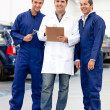 Stock Photo: Group of mechanics