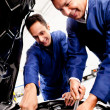 Stock Photo: Mechanics fixing a car