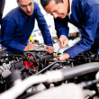 Car mechanics working — Stock Photo