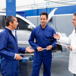 Stock Photo: Group of mechanics talking