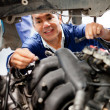 Mechanic fixing a car — Stock Photo #9557681