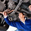 Mechanics fixing a car — Foto Stock