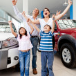 Happy family buying a car — Stock Photo