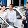 Couple buying a car — Stock Photo #9557690