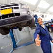 Happy mechanic with thumbs-up - Stock Photo