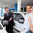 Couple at dealership — Stock Photo #9557693