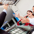 Excited couple buying a car — Stock Photo
