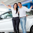 Happy couple with new car — Foto de Stock