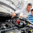 Stockfoto: Father teaching car mechanics